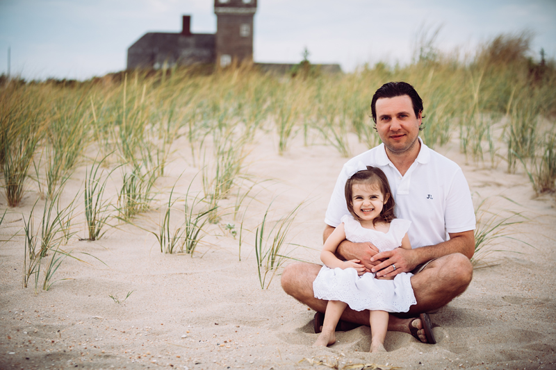 NJ Family Photographer, father and young daughter sitting at the beach together