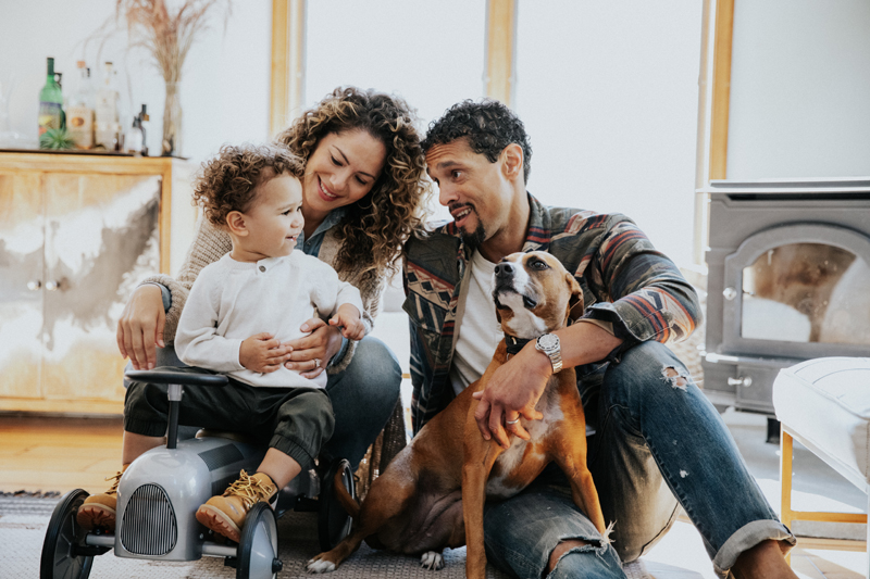 NJ Family Photographer, family of three sitting with their dog
