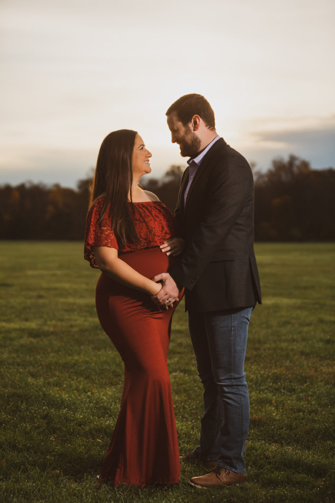 NJ Family Photographer, pregnant woman standing in field with her husband